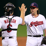 Cleveland Indians pitcher Chris Perez, right, is congratulated by catcher Lou Marson after the Indians defeated the Boston Red Sox 5-3 in a baseball game, Thursday, Aug. 9, 2012, in Clevelan …
