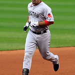 Boston Red Sox's Adrian Gonzalez runs the bases after hitting a two-run home run in the fourth inning of a baseball game against the Cleveland Indians, Thursday, Aug. 9, 2012, in Cleveland.  …