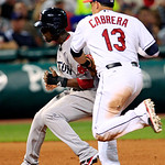 Boston Red Sox's Pedro Ciriaco is tagged out by Cleveland Indians' Asdrubal Cabrera in a rundown between second and third base in the seventh inning of a baseball game, Thursday, Aug. 9, 201 …