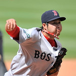 Boston Red Sox relief pitcher Junichi Tazawa, from Japan, delivers against the Cleveland Indians in the seventh inning of a baseball game on Sunday, Aug. 12, 2012, in Cleveland. (AP Photo/Da …