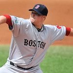 Boston Red Sox starting pitcher Jon Lester delivers against the Cleveland Indians in the second inning of a baseball game on Sunday, Aug. 12, 2012, in Cleveland. (AP Photo/David Richard)
