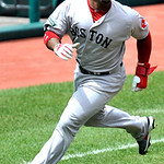 Boston Red Sox's Carl Crawford rounds third base while scoring on a double by Dustin Pedroia against the Cleveland Indian in the first inning of a baseball game, Sunday, Aug. 12, 2012, in Cl …
