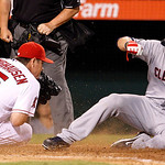 Cleveland Indians' Casey Kotchman scores on a passed ball by Los Angeles Angels pitcher Jason Isringhausen, who tries to cover the plate in the ninth inning of a baseball game in Anaheim, Ca …