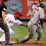 Cleveland Indians' Asdrubal Cabrera is picked off at second base by Los Angeles Angels second baseman Howard Kendrick in the first inning of a baseball game in Anaheim, Calif., Monday, Aug.  …