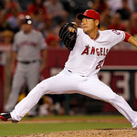 Los Angeles Angels pitcher Hisanori Takahashi, of Japan, pitches to the Cleveland Indians in the ninth inning of a baseball game in Anaheim, Calif., Monday, Aug. 13, 2012. (AP Photo/Reed Sax …