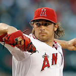 Los Angeles Angels starter C.J. Wilson pitches to the Cleveland Indians in the first inning of a baseball game in Anaheim, Calif., Monday, Aug. 13, 2012. (AP Photo/Reed Saxon)