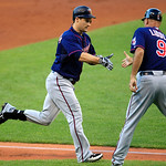 Minnesota Twins' Josh Willingham, left, is congratulated by third base coach Steve Liddle after Willingham hit a solo home run off Cleveland Indians starting pitcher Zach McAllister in the s …
