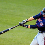 Minnesota Twins' Ryan Doumit hits a three-run home run off Cleveland Indians' pitcher Josh Tomlin in the second inning of a baseball game, Monday, Aug. 6, 2012, in Cleveland. Josh Willingham …