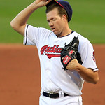 Cleveland Indians starting pitcher Zach McAllister adjusts his cap in the second inning of a baseball game against the Minnesota Twins, Monday, Aug. 6, 2012, in Cleveland. (AP Photo/Tony Dej …