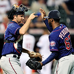 Minnesota Twins catcher Ryan Doumit, left, congratulates relief pitcher Luis Perdomo after their 14-3 win over the Cleveland Indians in a baseball game, Monday, Aug. 6, 2012, in Cleveland. ( …