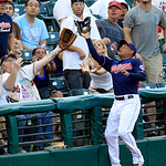 Cleveland Indians' Ezequiel Carrera catches a foul ball hit by Minnesota Twins' Ben Revere in the third inning of a baseball game, Tuesday, Aug. 7, 2012, in Cleveland. (AP Photo/Tony Dejak)