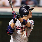Minnesota Twins' Tsuyoshi Nishioka hits a sacrifice fly off Cleveland Indians' Chris Perez in the ninth inning of a baseball game, Tuesday, Aug. 7, 2012, in Cleveland. Justin Morneau scored. …