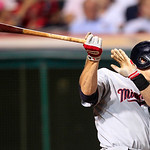 Minnesota Twins' Justin Morneau hits the ball against Cleveland Indians relief pitcher Joe Smith in the seventh inning of a baseball game, Tuesday, Aug. 7, 2012, in Cleveland. Morneau was sa …