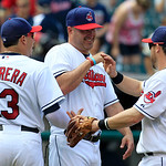 Cleveland Indians manager Manny Acta, center, smiles as he congratulates Asdrubal Cabrera, left, and Jason Kipnis after the Indians defeated the Minnesota Twins 6-2 in a baseball game, Wedne …