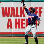 Minnesota Twins' Denard Span catches a ground ball hit by Cleveland Indians' Shin-Soo Choo in the seventh inning of a baseball game, Wednesday, Aug. 8, 2012, in Cleveland. Choo was safe at f …