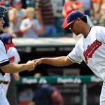 Cleveland Indians catcher Lou Marson, left, congratulates pitcher Esmil Rogers after the Indians defeated the Minnesota Twins 6-2 in a baseball game, Wednesday, Aug. 8, 2012, in Cleveland. ( …