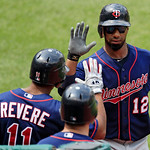 Minnesota Twins' Alexi Casilla (12) is congratulated by teammates after hitting a two-run home run off Cleveland Indians starting pitcher Justin Masterson in the fifth inning of a baseball g …