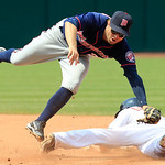 Cleveland Indians' Brent Lillibridge safely steals to second base as Minnesota Twins' Brian Dozier is late with the tag during the eighth inning of a baseball game, Wednesday, Aug. 8, 2012,  …
