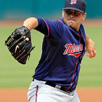 Minnesota Twins starting pitcher Brian Duensing pitches in the first inning of a baseball game against the Cleveland Indians, Wednesday, Aug. 8, 2012, in Cleveland. (AP Photo/Tony Dejak)