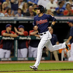 Cleveland Indians' Drew Stubbs runs home to score from third on a sacrifice fly by Asdrubal Cabrera in the eighth inning of a baseball game against the Toronto Blue Jays Tuesday, July 9, 201 …