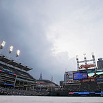 Storm clouds roll in over a tarp-covered Progressive Field delaying the start of a baseball game between the Toronto Blue Jays and Cleveland Indians Tuesday, July 9, 2013, in Cleveland. (AP  …