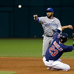 Toronto Blue Jays second baseman Emilio Bonifacio throws over Cleveland Indians' Michael Brantley (23) to complete a double play on Mark Reynolds to end the fourth inning of a baseball game  …