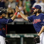 Cleveland Indians catcher Carlos Santana, left, and relief pitcher Chris Perez celebrate the Indians' 3-0 win over the Toronto Blue Jays in a baseball game Tuesday, July 9, 2013, in Clevelan …