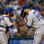Toronto Blue Jays catcher J.P. Arencibia, left, and starting pitcher Josh Johnson (55) confer in the fourth inning of a baseball game Tuesday, July 9, 2013, in Cleveland. (AP Photo/Mark Dunc …