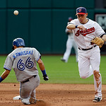 Cleveland Indians shortstop Asdrubal Cabrera throws over Toronto Blue Jays' Munenori Kawasaki (66) to complete a double play on Jose Reyes in the third inning of a baseball game Wednesday, J …