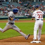 Toronto Blue Jays' Munenori Kawasaki can't beat the throw to Cleveland Indians first baseman Nick Swisher (33) for a ground out n the sixth inning of a baseball game Wednesday, July 10, 2013 …