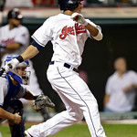 Cleveland Indians' Michael Brantley watches his RBI single off Toronto Blue Jays relief pitcher Brett Cecil during the eighth inning of a baseball game Wednesday, July 10, 2013, in Cleveland …