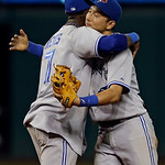 Toronto Blue Jays' Jose Reyes, left, hugs Munenori Kawasaki after a 5-4 win over the Cleveland Indians in a baseball game Wednesday, July 10, 2013, in Cleveland. (AP Photo/Mark Duncan)