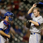 Toronto Blue Jays catcher J.P. Arencibia, left, come to the mound to talk to relief pitcher Casey Janssen, right, in the ninth inning of a baseball game against the Cleveland Indians Wednesd …