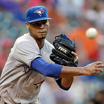 Toronto Blue Jays relief pitcher Esmil Rogers throws to first to hold Cleveland Indians' Asdrubal Cabrera close in the fifth inning of a baseball game Wednesday, July 10, 2013, in Cleveland. …