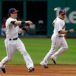 Cleveland Indians second baseman Jason Kipnis throws out Toronto Blue Jays' Edwin Encarnacion at first in the first inning of a baseball game Wednesday, July 10, 2013, in Cleveland. (AP Phot …