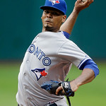 Toronto Blue Jays pitcher Esmil Rogers delivers against the Cleveland Indians in the first inning of a baseball game Wednesday, July 10, 2013, in Cleveland. (AP Photo/Mark Duncan)