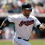 Cleveland Indians' Yan Gomes runs out a ground ball in the eighth inning of a baseball game against the Toronto Blue Jays, Thursday, July 11, 2013, in Cleveland. Gomes was out at first base. …