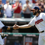 Cleveland Indians relief pitcher Chris Perez, right, is congratulated by catcher Yan Gomes after the Indians defeated the Toronto Blue Jays 4-2 in a baseball game, Thursday, July 11, 2013, i …