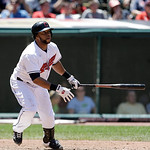 Cleveland Indians' Carlos Santana watches his ball after hitting an RBI-triple off Toronto Blue Jays relief pitcher Darren Oliver in the eighth inning of a baseball game, Thursday, July 11, …