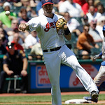 Cleveland Indians' Lonnie Chisenhall throws out Toronto Blue Jays' Jose Reyes at first base in the third inning of a baseball game, Thursday, July 11, 2013, in Cleveland. (AP Photo/Tony Deja …