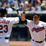 Cleveland Indians' Asdrubal Cabrera, right, is congratulated by Michael Brantley after Cabrera hit a solo home run off Toronto Blue Jays starting pitcher R.A. Dickey in the first inning of a …