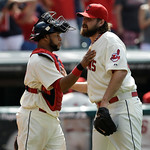 Cleveland Indians' Carlos Santana, left, congratulates relief pitcher Chris Perez after the Indians defeated the Kansas City Royals 6-4 in a baseball game, Sunday, July 14, 2013, in Clevelan …