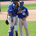 Kansas City Royals relief pitcher Tim Collins, right, talks with catcher Salvador Perez in the sixth inning of a baseball game against the Cleveland Indians, Sunday, July 14, 2013, in Clevel …