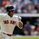 Cleveland Indians' Michael Brantley runs out a ground ball in the eighth inning of a baseball game against the Kansas City Royals, Sunday, July 14, 2013, in Cleveland. (AP Photo/Tony Dejak)