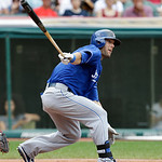 Kansas City Royals' Alex Gordon hits an RBI-single off Cleveland Indians starting pitcher Ubaldo Jimenez in the second inning of a baseball game lon Sunday, July 14, 2013, in Cleveland. Davi …