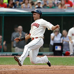 Cleveland Indians' Michael Brantley slides home safely on a RBI-double by Carlos Santana in the third inning of a baseball game against the Kansas City Royals, Sunday, July 14, 2013, in Clev …