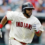 Cleveland Indians' Carlos Santana runs the bases after hitting an RBI double off Kansas City Royals starting pitcher James Shields in the third inning of a baseball game, Sunday, July 14, 20 …