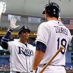 Tampa Bay Rays' Carlos Pena, left, is congratulated by Ben Zobrist after his two-run home run during the first inning of a baseball game against the Cleveland Indians on Tuesday, July 17, 20 …