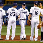 Tampa Bay Rays' Matt Joyce, center, celebrates the Rays' 4-2 win over the Cleveland Indians with teammates, from left, Elliot Johnson, Carlos Pena, Ben Zobrist and Jeff Keppinger, after the  …