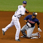 Tampa Bay Rays second baseman Ben Zobrist, left, and Cleveland Indians' Carlos Santana watch a throw to first base to complete a double play on Shelley Duncan during the sixth inning of a ba …
